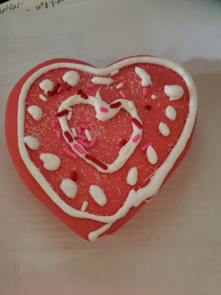 decorated heart shaped cookies with white dots