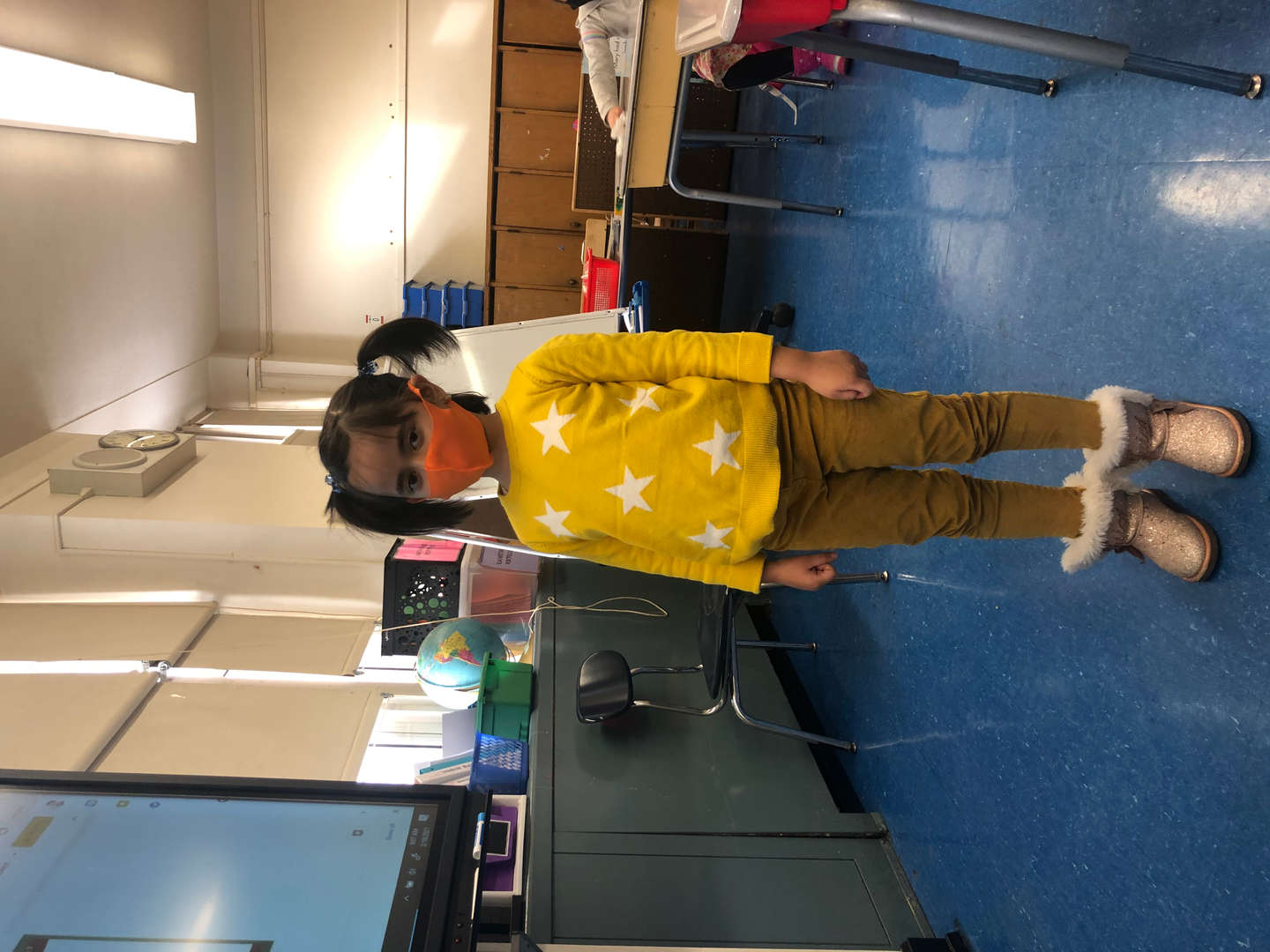 student wears yellow with white dots