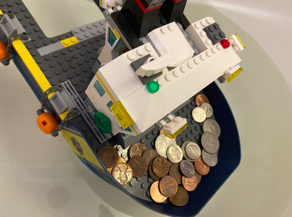 this strong lego boat carries many pennies