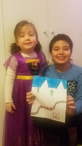 brother and sister sharing their artwork