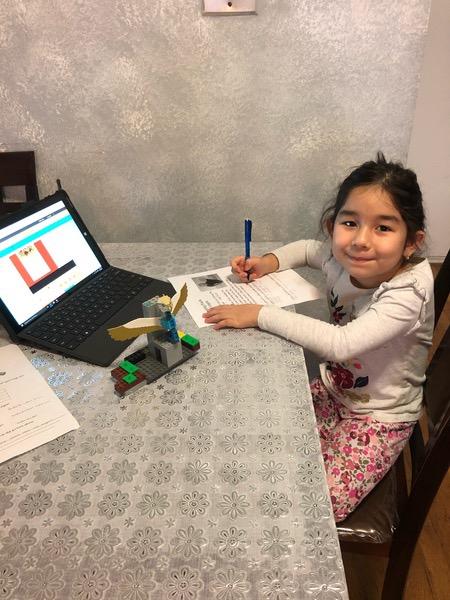 girl works near her laptop