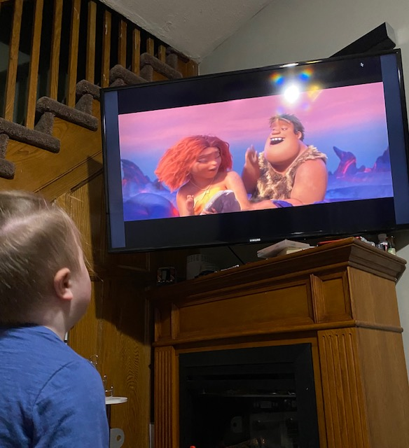 Boy watching a movie on TV