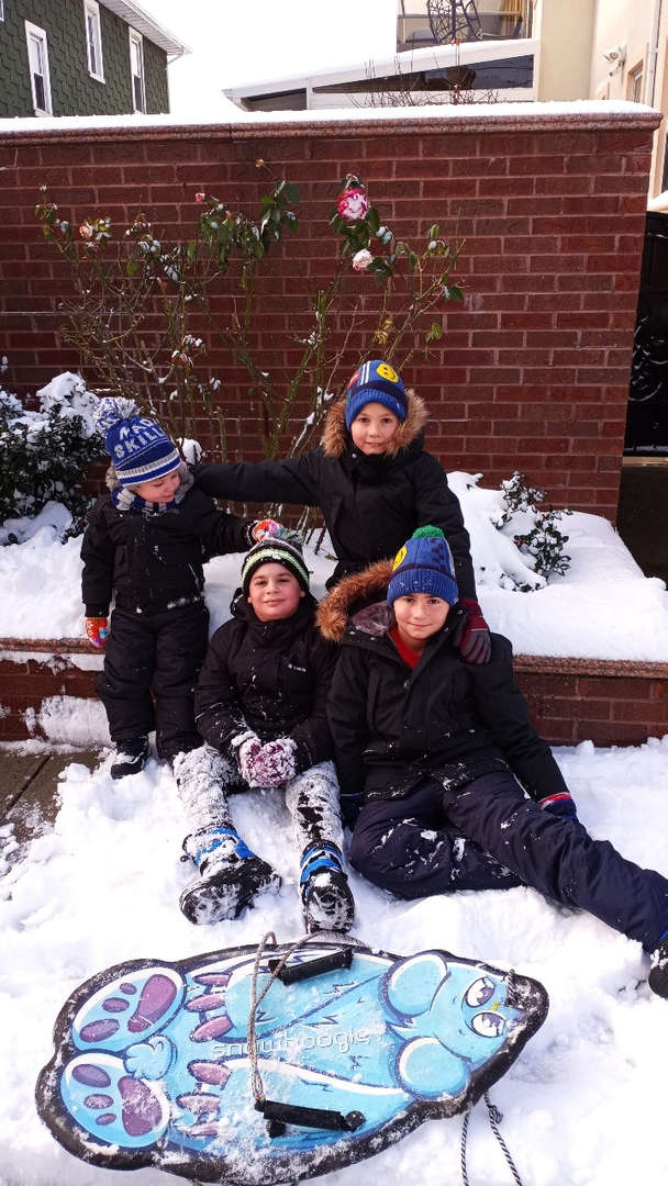 a handful of children playing in the snow