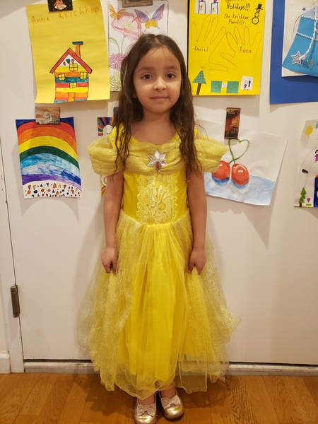 student wears yellow dress