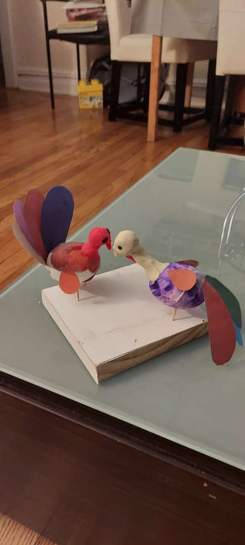 Turkey models made with clay kissing