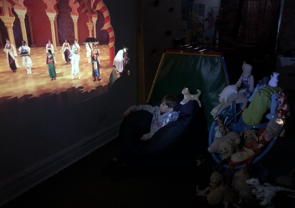 child enjoys the play on his tv