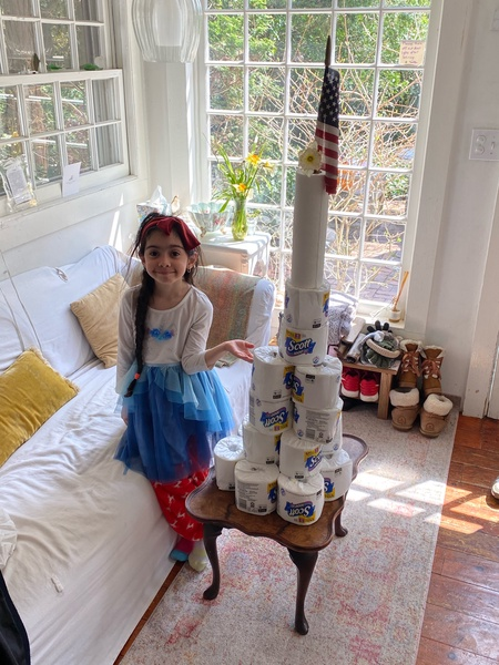 the girl's cup tower is taller than her