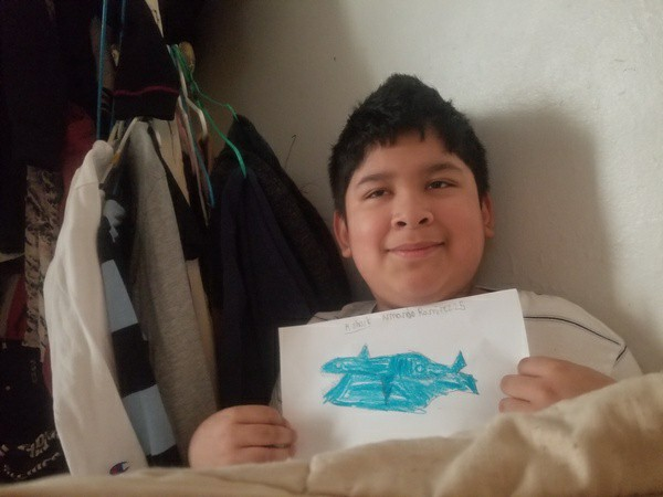 child shares his drawing