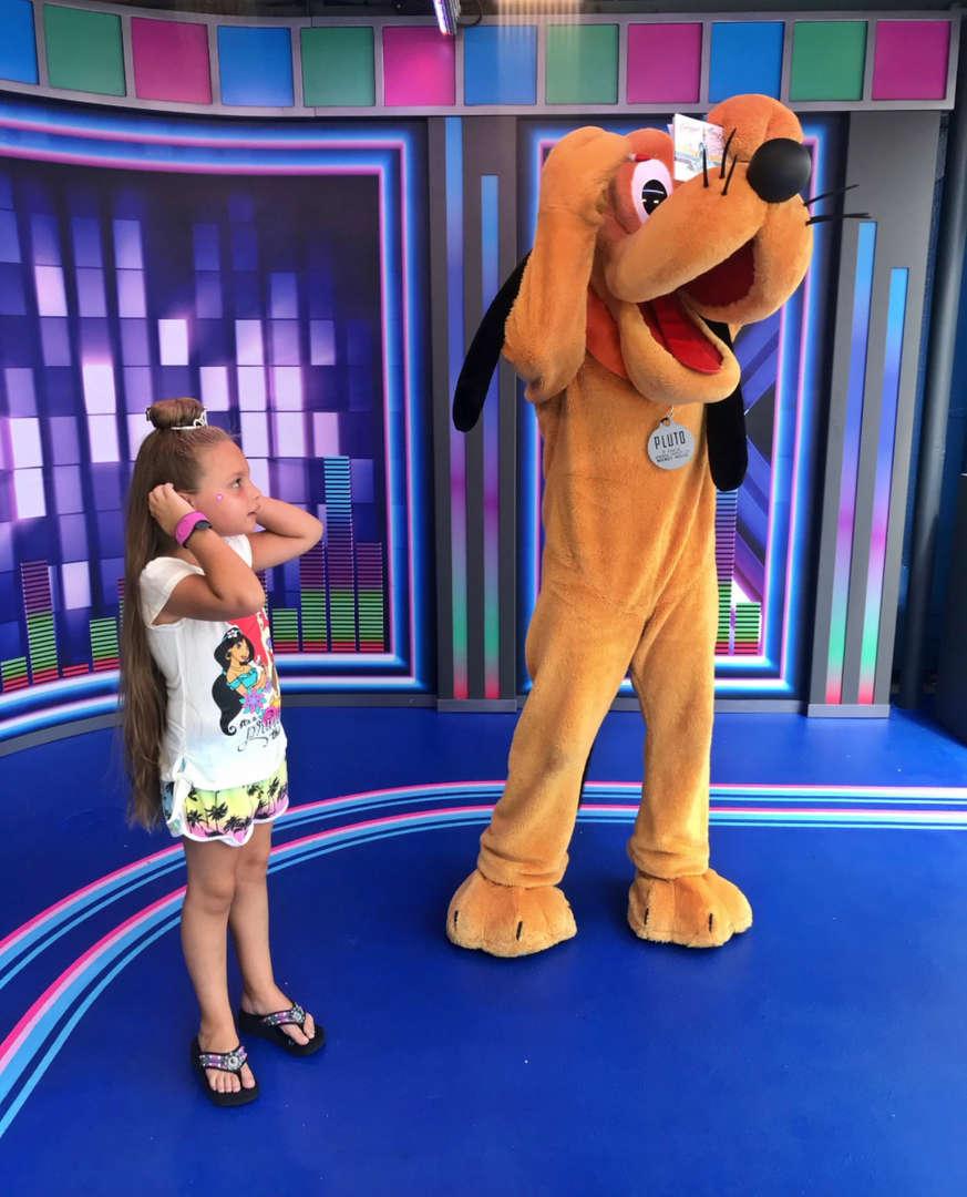 posing with Pluto