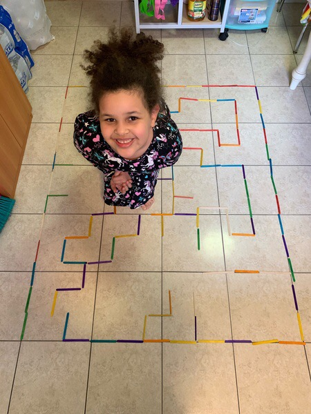a child in the middle of a maze