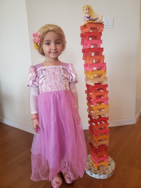 girl in process costume near building