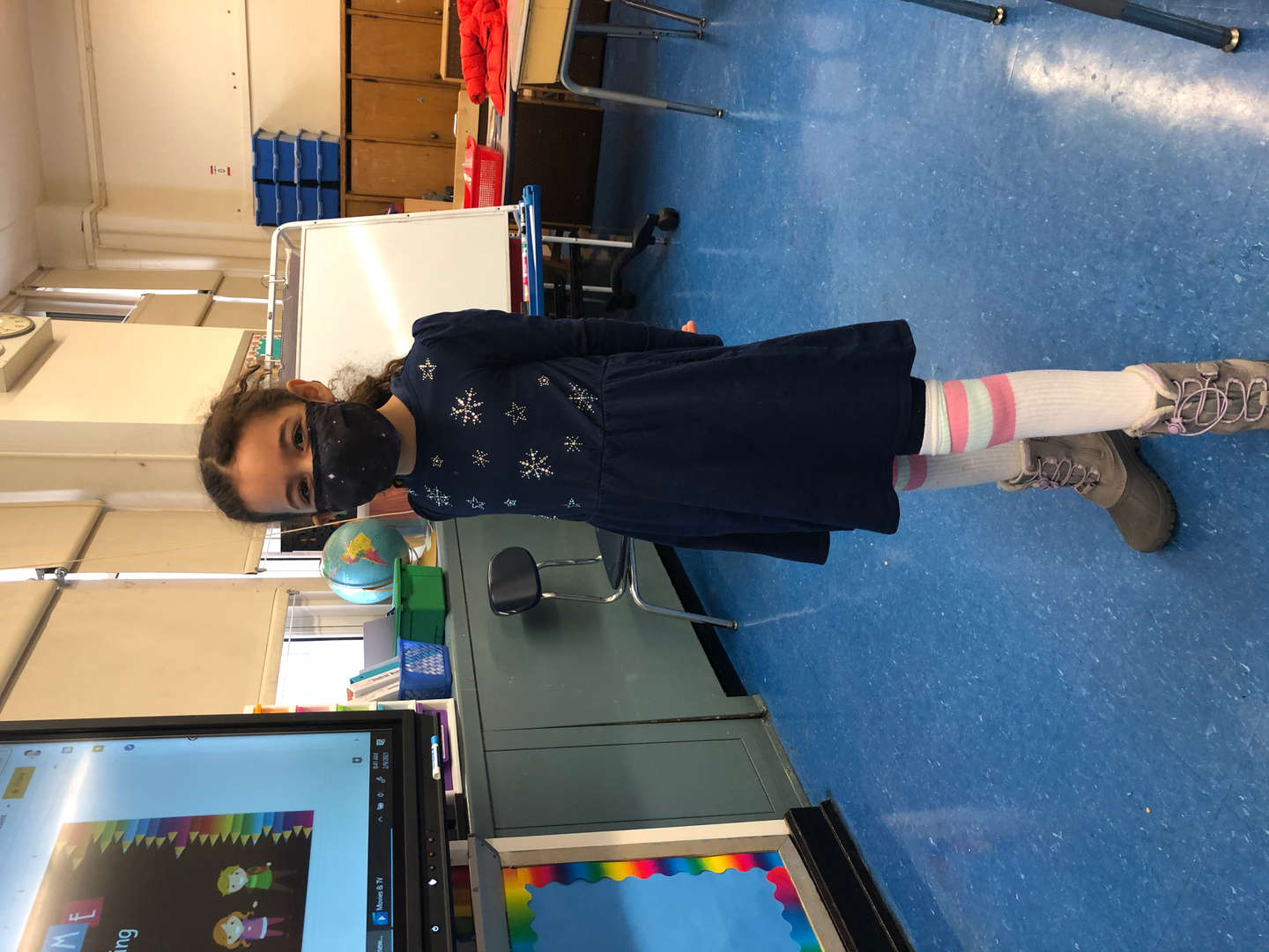 student wears blue dress with high white socks