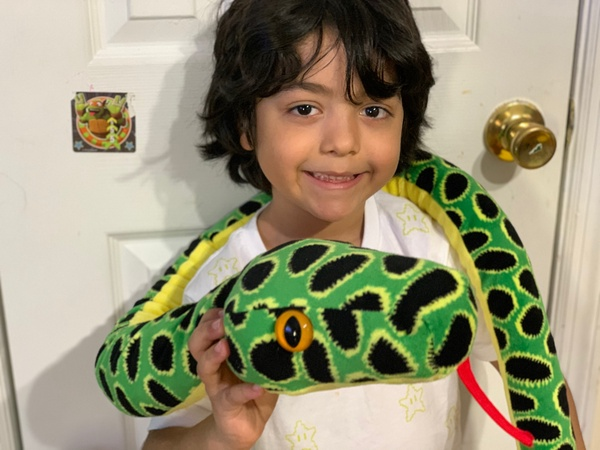 child with stuffed snake