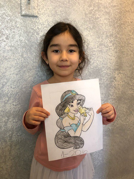 girl holds a Jasmin drawing