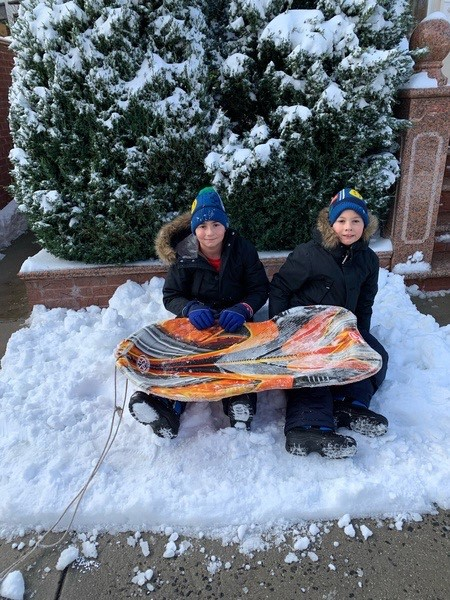 two friends with their sleds
