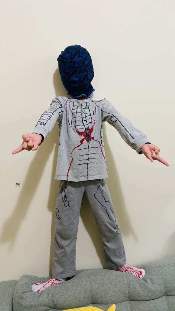 child points with both fingers