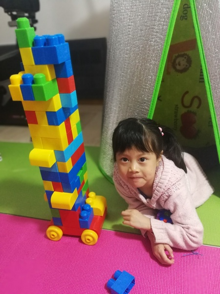 Girl shows off her Lego building