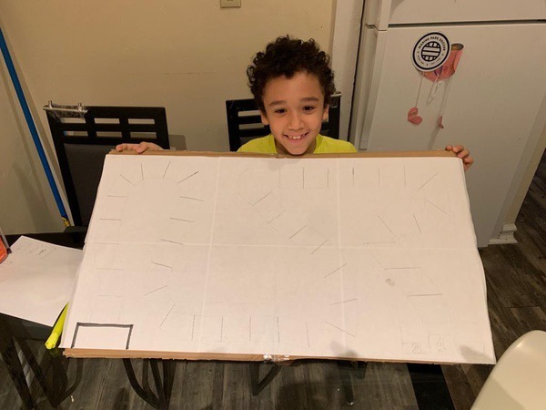 child holds large chart