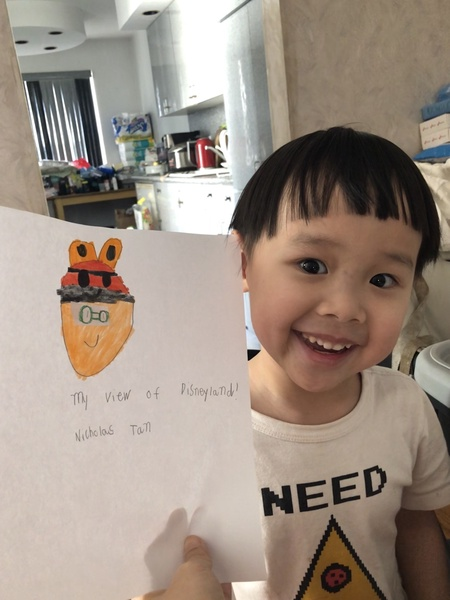 child smiling with his work