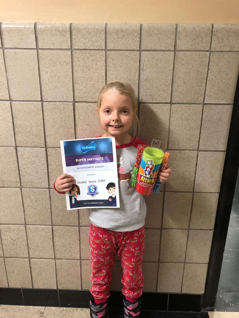 Annabell holds her game and certificate.