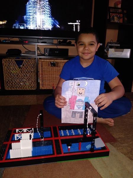 Boy presents Lego character drawing
