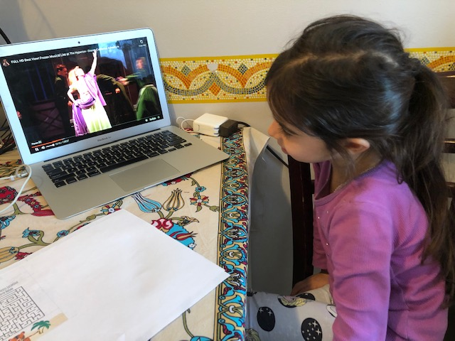 girl watches the Disney play