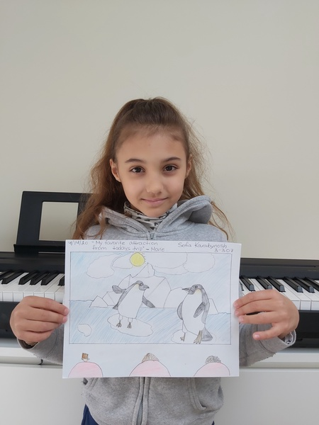 girl stands in front pf piano with her penguin work