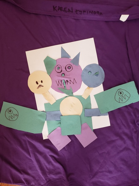 Child's artwork using purple green and yellow construction paper