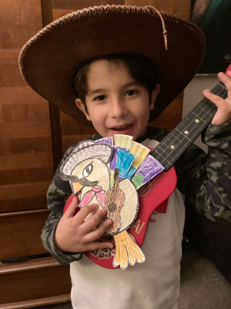 Boy playing a guitar with his turkey