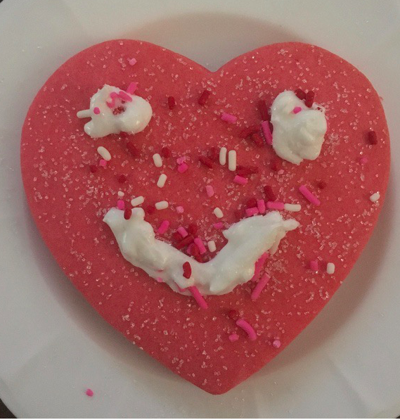 face on a heart cookie