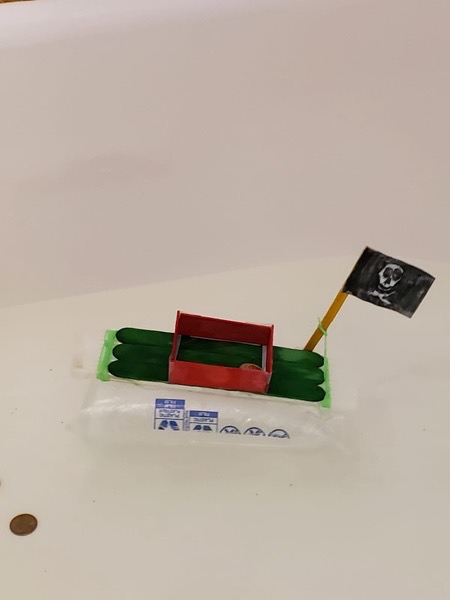 the green and red boat floats