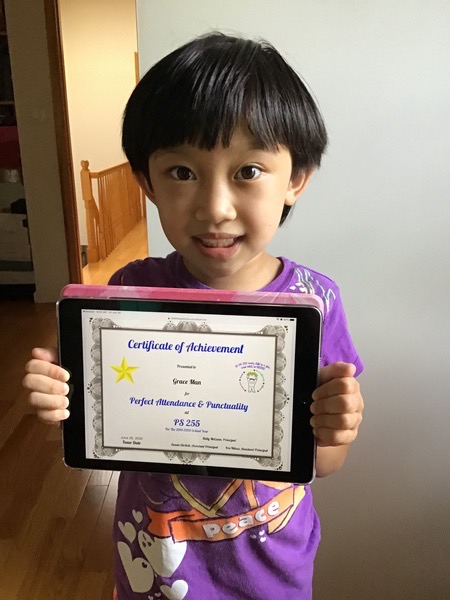 smiling girl holds her iPad showing her certificate