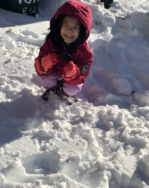 child sitting in the snow