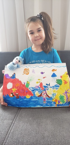 the child shares their colorful work