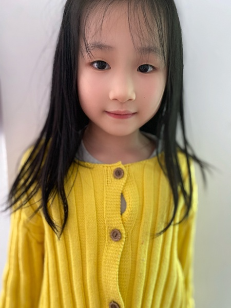 girl wears yellow shirt with buttons