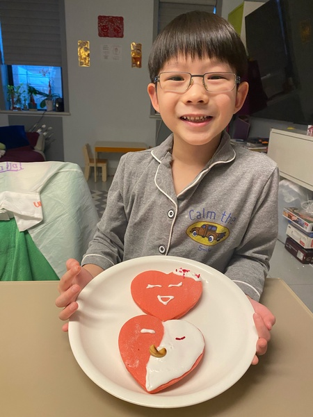 boy showing his decorated cookie