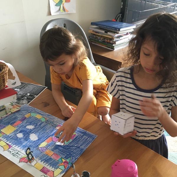 children making board game
