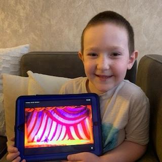 curtains on the boy's iPad