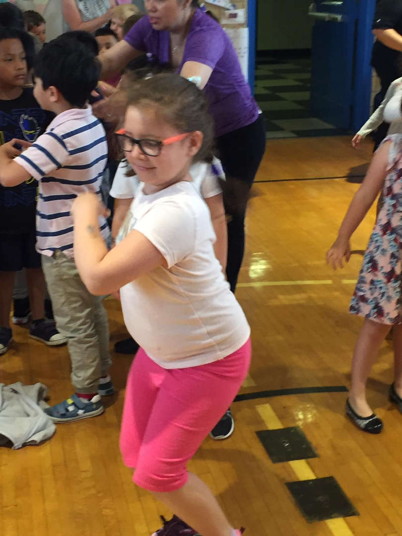 A student dances to music.
