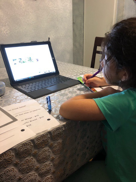 child completed her work as she watches the computer