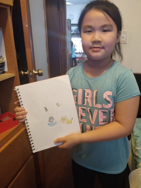 the girl holds her zoo writing