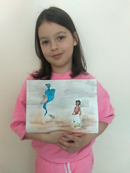 girl smiles with her Aladdin picture