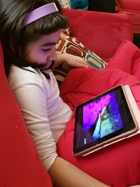 girl watching Disney movie