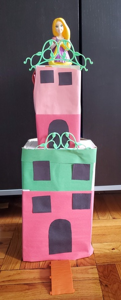child made a building out of recycled boxes