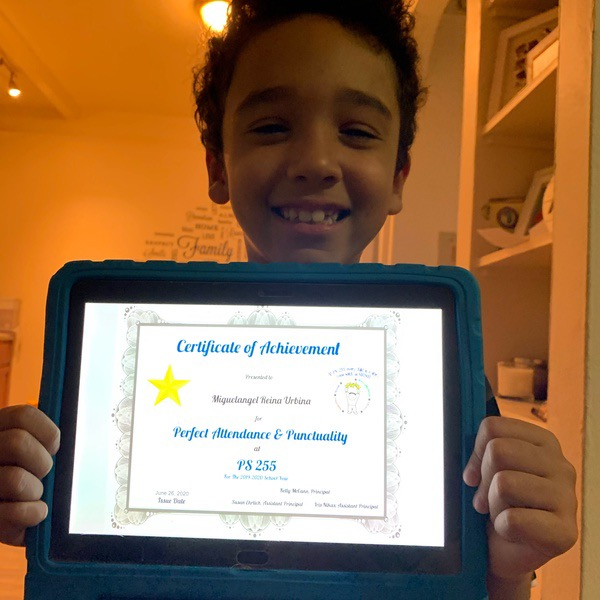 child hold certificate displayed on an iPad with a blue and black case