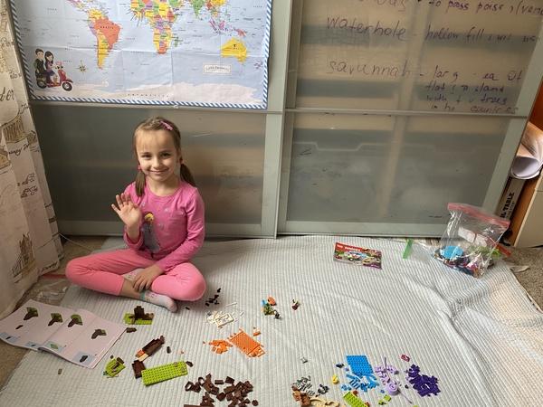 Girl sorts through Lego pieces
