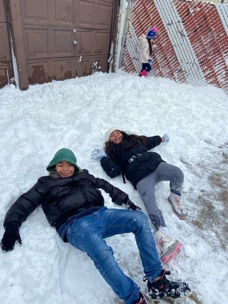 friends laying in the snow!