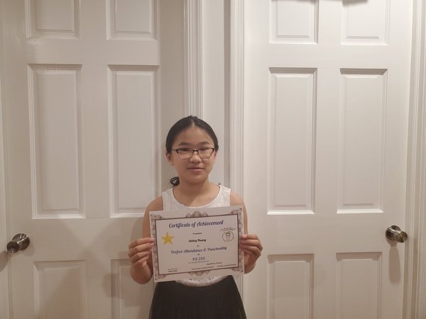 child holds certificate between two white doors