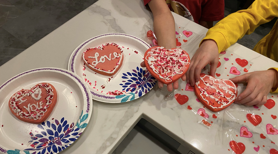 boys show their valentine's cookies