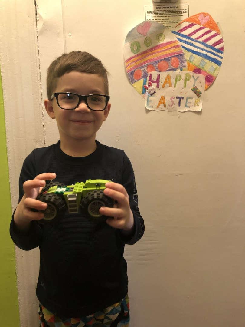 Boy shares the Lego car he made
